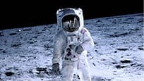 An astronaut walking on the moon facing the camera