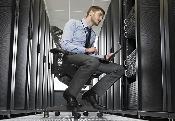 Businessman sitting in data center